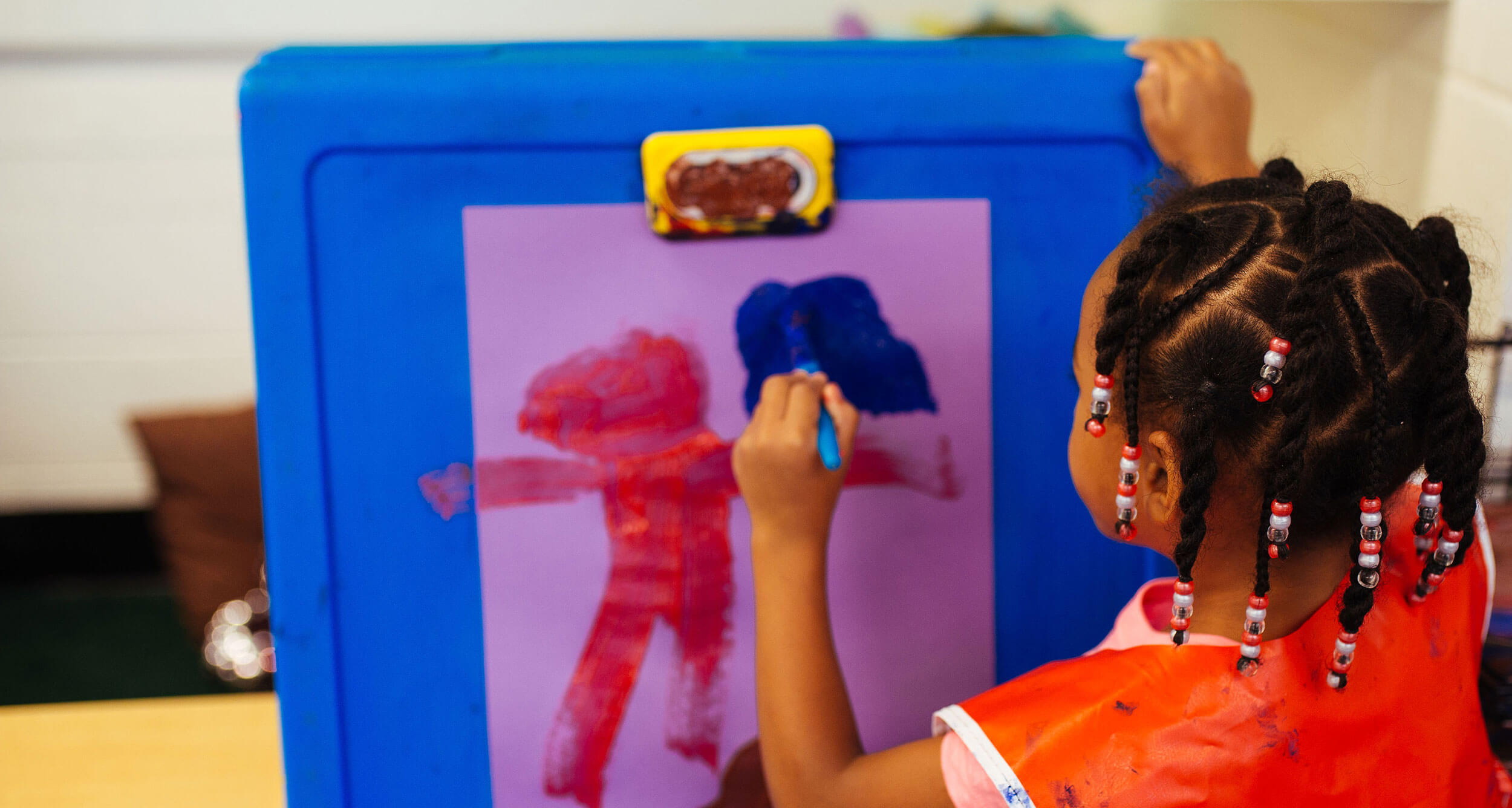 Picture of young Black child painting